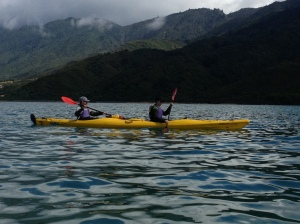 Paddling across with the storm coming over the mountains