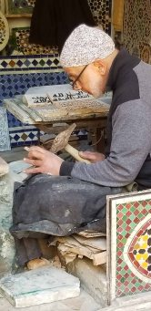 This artisan was etching inscriptions on stones
