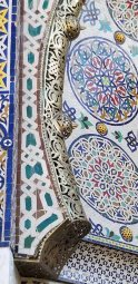 The detail is not only the tiled mosaic but the metal edging